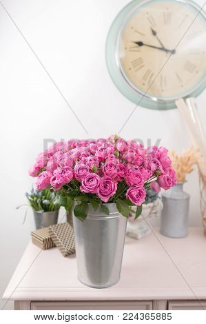 Rose peony Misty Bubbles. Bouquet flowers of pink roses in metal vase. Shabby chic home decor