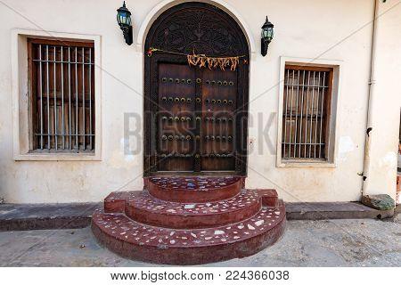 Close up traditional obsolete wooden door in Stone Town, Zanzibar