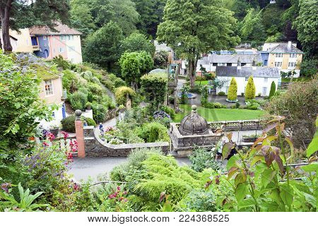 Portmeirion, Gwynedd, Wales - July 3, 2007: Tourist village Portmeirion in Wales with houses and gardens designed in the theme of an Italian village