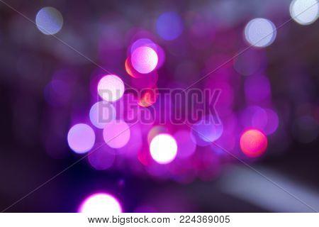 Pink lights background . Pink and purple bokeh glitter vintage lights background defocused