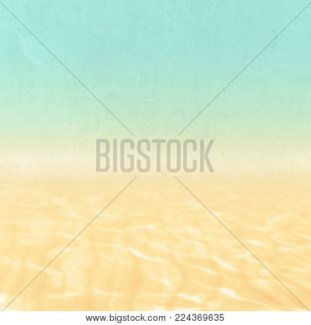 Beach background - abstract holiday and vacation concept with blue green sky and sand and water texture in retro design