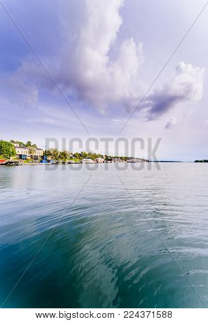 Unusual view from the water on the archipelago which situated between Sweden and Finland. ?land island. Coastline with green nature, deep blue water and amaizing sky with clouds.