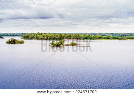 Beautiful panoramic view of Stockholm archipelago, Sweden. Green nature, little rock islands and deep water. Summer day with clouds