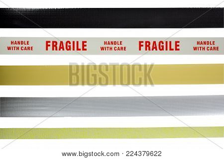A different kind of adhesive tape on a white background