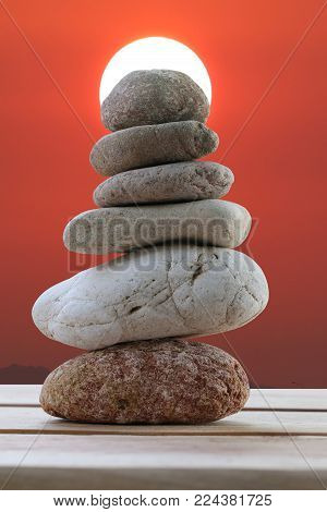 Balance Stones Stacked To Pyramid In The Sunset Background To Spa Ideas Design Or Freedom And Stabil