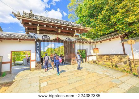 Kyoto, Japan - April 24, 2017: people crossing gate to entrance of Maruyama Park coming from the famous Chion-in Sanmon. Maruyama Park is the Kyoto's most famous cherry-blossom viewing hanami spot.