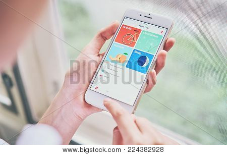 BANGKOK ,THAILAND - January 31, 2018 : women holding smartphone on the Health app screen on iPhone 6. is an application for iOS 11 which monitor the fitness data of the user.
