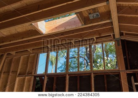 Interior construction details, sistering studs, added short stud wall to raise roof, skylight framing, horizontal aspect