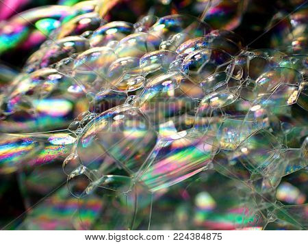 Soap bubbles / A soap bubble is an extremely thin film of soapy water enclosing air that forms a hollow sphere with an iridescent surface