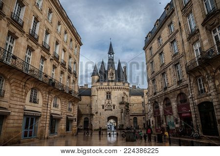 BORDEAUX, FRANCE - DECEMBER 26, 2017: Porte Cailhau (Cailhau Gate) in the city center of Bordeaux. This medieval gothic gate is one of the symbols of the older part of the city