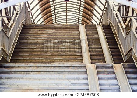 Stairway in the air passage through the track. Overground crossing over railroad tracks.