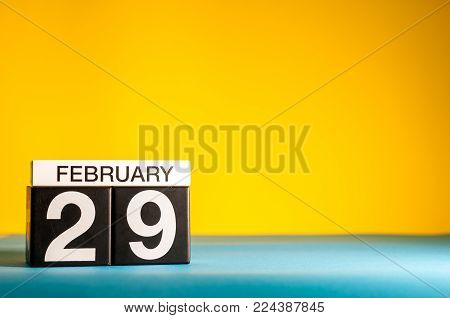 February 29th. Day 29 of february month, calendar on yellow background. Winter time, leap-year. Empty space for text.
