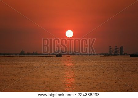 Sunset in the tropical sea of Sriracha coastal district of Chonburi province in Thailand.