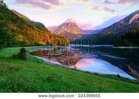 Amazing summer morning on the fantastic Swiss lake Obersee, located near Nafels village. Alps, Switzerland, Europe. Landscape photography