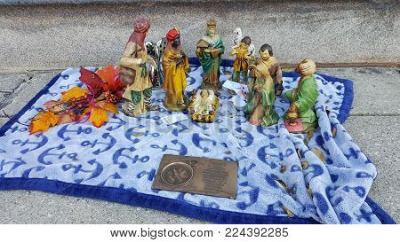 Nativity Scene on a blue cloth with Baby Jesus, Mary, Joseph and the three wise men Christmas Holiday season