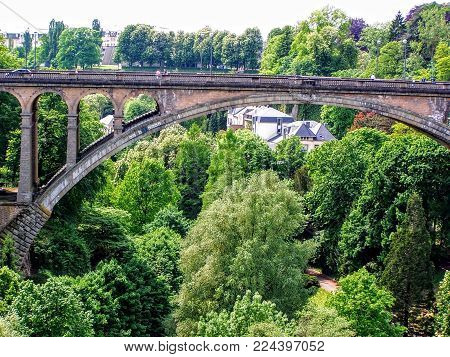 Luxembourg Old Medieval City With Surrounding Walls In Spring With Train, Gardens, Bridges And Build