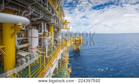 Panorama of offshore oil and gas central processing platform and wellhead platform, raw material for petrochemical industry.