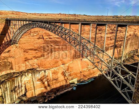 Glen Canyon Dam Bridge Over The Colorado River Sand Stone Walls Traveling.