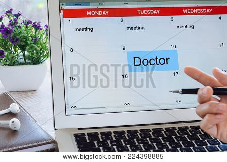 Doctor's appointment concept, Schedule Planning laptop on the calendar as reminders of important dates or to schedule a meeting or event reminders.