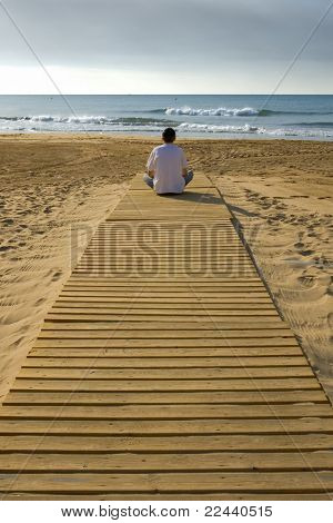 watching the sea from a wooden pathway