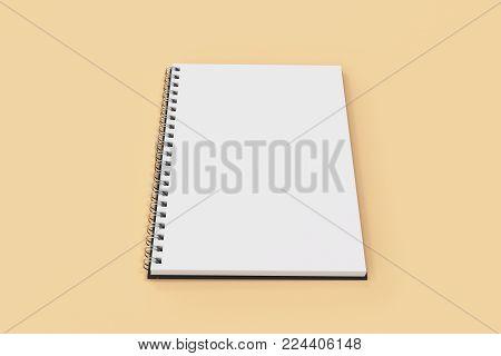 Opend Notebook Spiral Bound On Orange Background
