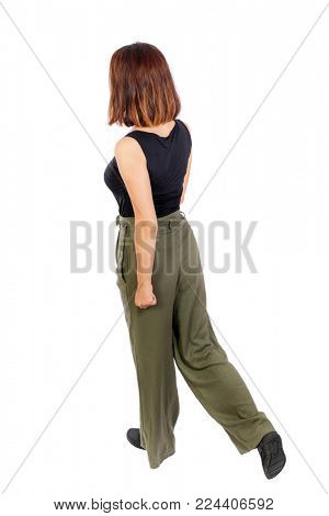 back view of walking  woman. beautiful blonde girl in motion.  backside view of person.  Rear view people collection. Isolated over white background. Top view of a girl in green trousers walking sidew