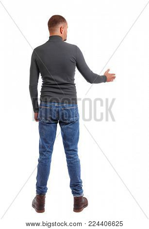 Back side view of man  in shirt handshake.  Rear view people collection.  backside view of person.  Isolated over white background. a shortly cropped man in a dark jacket stretches out his hand