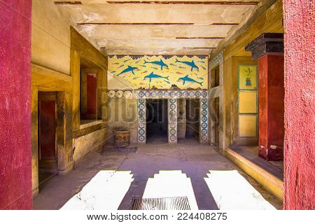 Heraklion, Greece - January 28, 2018: Copies of fresco in a hall at the palace of Knossos, famous ancient city in Crete, located near modern Heraklion city