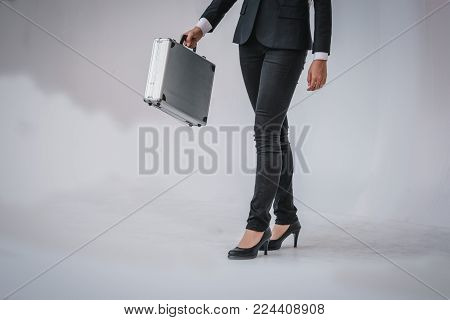 Smart Woman In Black Suit Is Holding Briefcase