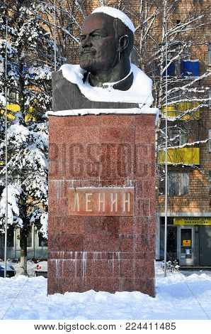 Moscow, Russia - January 3, 2018: Snow covered bust of Lenin in Khimki, Russia