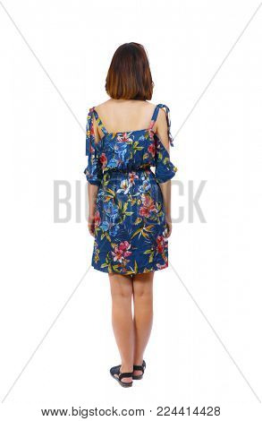 back view of standing young beautiful  woman.  girl  watching. Rear view people collection.  backside view of person.  A girl in a colorful dress is worth her hands down.