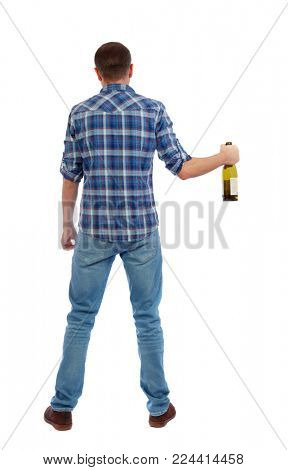 Back view of drunk man with  bottle of wine. drinking young guy. Rear view people collection.  backside view of person.  Isolated over white background.  A drunk man holds a bottle of alcohol uncerta