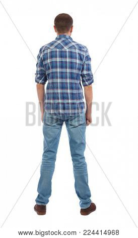 Back view of man in jeans. Standing young guy. Rear view people collection.  backside view of person.  Isolated over white background. A man in a checkered blue shirt is worth his hands down.
