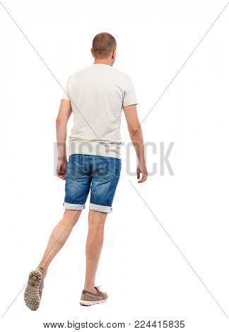 Back view of going  handsome man. walking young guy . Rear view people collection.  backside view of person.  Isolated over white background. The guy in denim shorts leaves