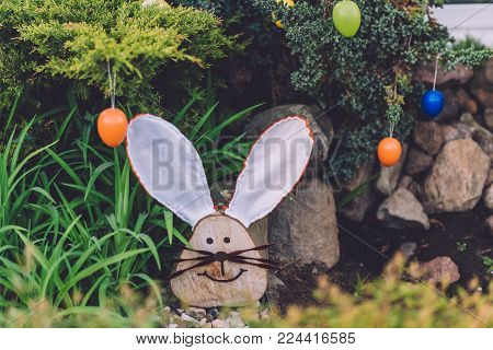April, 17th, 2017 - Potsdam, Brandenburg, Germany. Traditional festive Easter handmade decorations, such as funny rabbit, eggs and plants during Easter celebration in Potsdam.