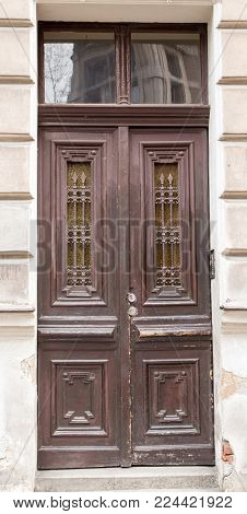 The vintage design brown  wooden front door of an old house