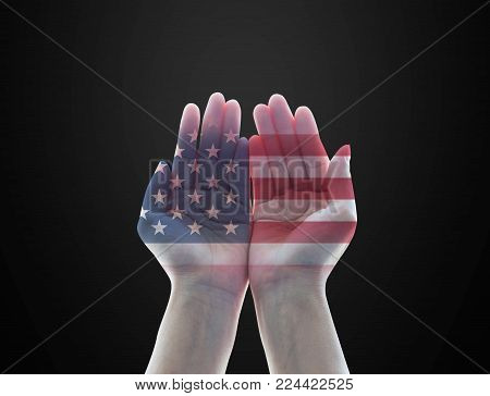 America flag pattern on woman's hands with open palms on black background for USA public holiday remembrance concept