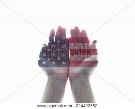 America flag pattern on woman's hands with open palms on white background
