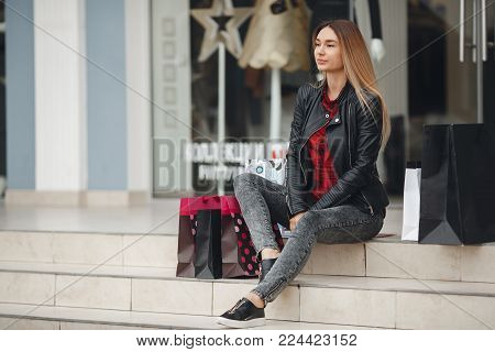 Portrait Of Young Beautiful Women With Her Shopping Bags.a Young Beautiful Woman With Long Blond Hai