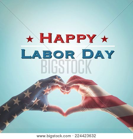 American flag pattern on people hands in heart shaped form isolated on vintage blue sky background: Memorial day Happy columbus day Patriot day, USA Independence Labor Loyalty day symbolic concept
