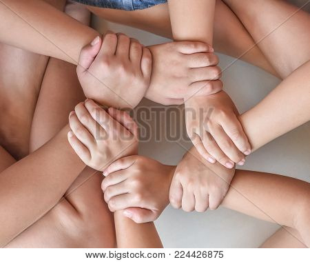 Circle of friend's unity , kid's friendship concept with children's hands bonding in circle