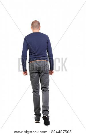 Back view of going  handsome man. walking young guy . Rear view people collection.  backside view of person.  Isolated over white background. A man in trousers and sneakers goes to the distance.