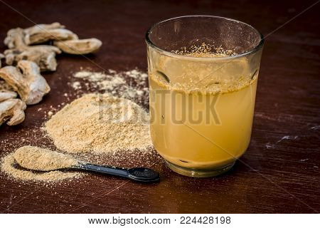 Close Up Of Extracted Water Of Dried Ginger,zingiber Officinale Or Soth With Raw Dried Ginger.