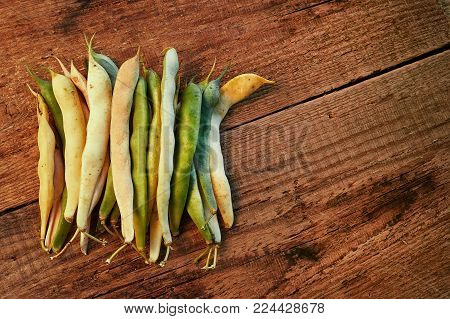 Healthy food. String beans, green and yelow raw asparagus. Close-up on a wooden table. Yardlong bean. Copy-space