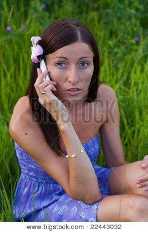 Girl Talking On The Phone In The Park