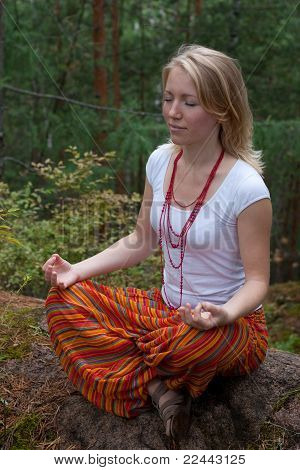 Girl Practices Yoga In The Woods