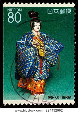 Moscow, Russia - January 31, 2018: A stamp printed in Japan shows Kakitsubata (Iris), Japanese Noh dancer doll, series