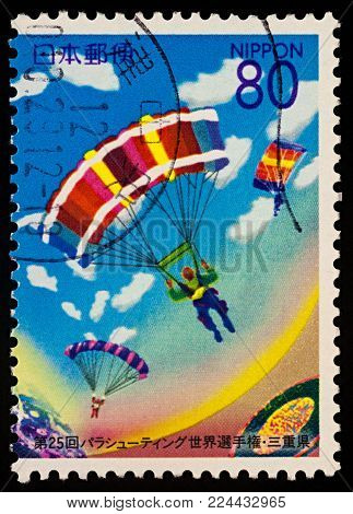 Moscow, Russia - January 31, 2018: A stamp printed in Japan shows Accuracy Landing, dedicated to the 25th World Parachuting Championships, series