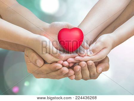 Life insurance and health assurance for family protection concept with father - children supporting red heart together