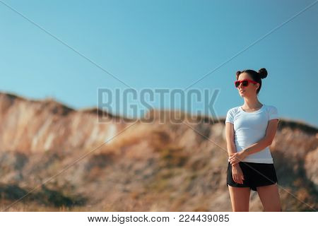 Sports woman with Space Buns Hairstyle Wearing Active Wear Outdoors